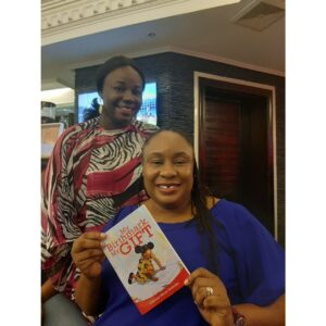 Me and Chioma Ifeanyi-Eze (CEO of AccountingHub) and a copy of my book